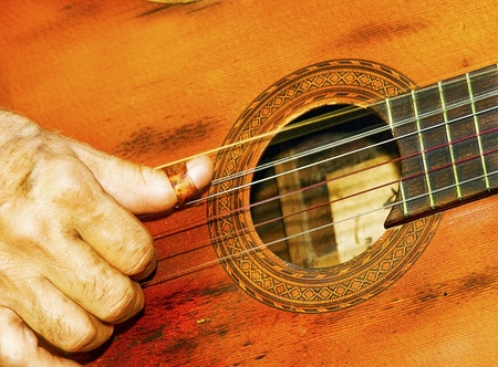 fandango: Close-Up of a Classic Old Guitar Playing  Stock Photo