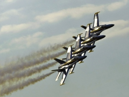 afterburner: FLORIDA, USA - NOVEMBER 6: Blue Angels fly in formation during performance on Wings Over Homestead on November 6 2010 at Homestead, Fl. USA. This event takes place at the Homestead Air Force Base