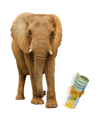 pricey:  Elephant kicking prescription bottle with pills and dollars Stock Photo