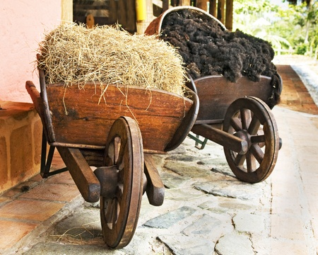 barrow: Farm Wooden Wheelbarrows with Hay and Wool