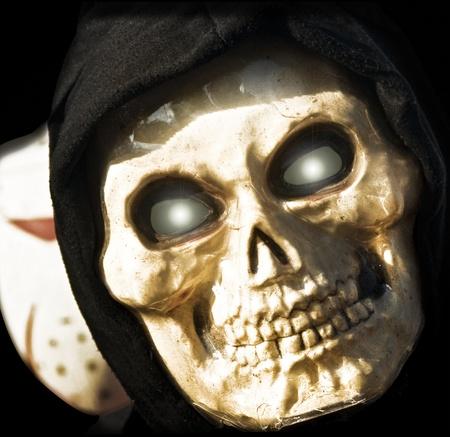 evil skull: Grim Reaper on the Shadows