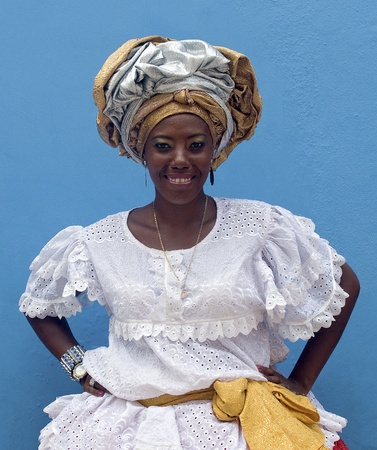 SALVADOR, BRAZIL- DECEMBER 9: African-Brazilian Woman Shows typical costume on December 9, 2012 in Salvador, Brazil. African roots are kept very strong in the Bahia state of North Brazil. Editorial