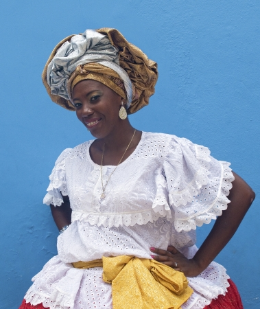 SALVADOR, BRAZIL- DECEMBER 9: Unidentified African-Brazilian Woman Shows typical costume on December 9, 2012 in Salvador, Brazil. African roots are kept very strong in the Bahia state of North Brazil. Banco de Imagens - 17808935