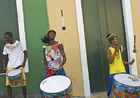 SALVADOR, BRAZIL - DECEMBER 8: Samba street performers playing and doing stunts in the Pelourinho area in Salvador, Brazil on December 8, 2012.