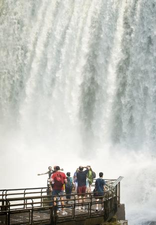 Tourists Enjoying Huge Waterfall