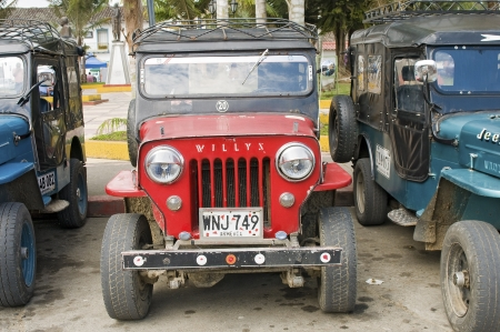 willy: SALENTO, COLOMBIA - JUNE 17: Willy Jeeps ready to take trekkers on the dirt roads crossing Cocora Valley, on June 17, 2012 in Salento, Colombia. Cocora has the tallest palm trees in the world.