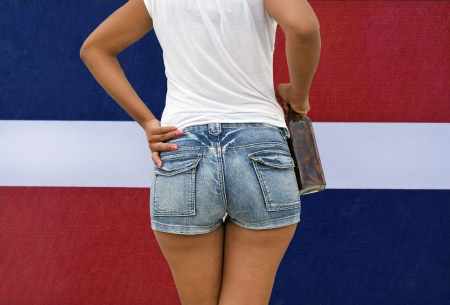 butt: Woman Holding a Mamajuana Bottle, The Typical Home Made Dominican Republic Beverage