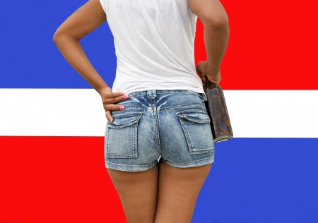 dominican republic: Holding a Mamajuana Bottle, The Typical Dominican Republic Beverage Home Made of  Roots.