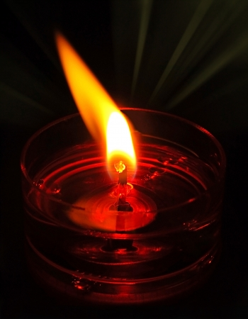irradiate: Close up of the Flame of an Abstract Oil Candle