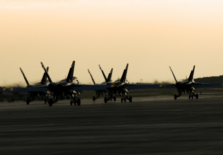 afterburner: Silhouetted Jets Landing in Formation