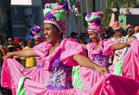 SANTO DOMINGO, DOMINICAN REPUBLIC - MARCH 6: Dancers parading at Malecon Carnival on March 6, 2011 in Santo Domingo, Dominican Republic. Exotic customs are important part of this annual event.