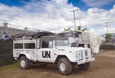 Ouanaminthe , HAITI - NOV 16, United Nations Peacekeepers Mission trucks guarding the Haitian border cross on November 16, 2013 in Ouanaminthe , Haiti Editorial