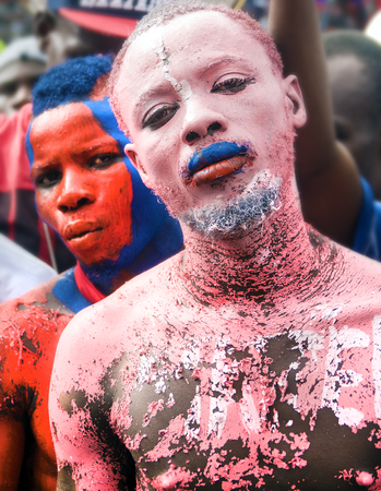 CAP-HAITIEN, HAITI - NOV 18, Painted supporters of President Martelly expecting life improvements during his visit on November 18, 2013 in Cap-Haitien, Haiti