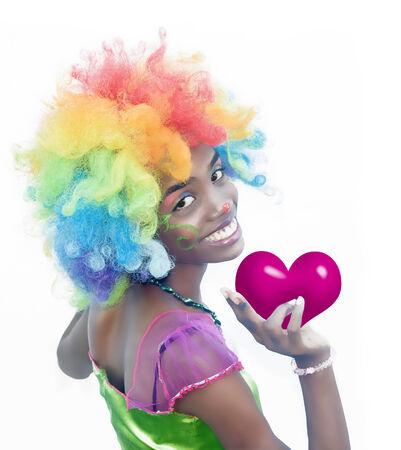 Happy Female Clown Holding a Heart Banco de Imagens