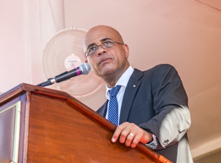 CAP-HAITIEN, HAITI - NOV 18, President of Haiti Michel Martelly speech on the public Nazareth Plaza for the anniversary of the War for Haitian Independence on November 18, 2013 in Cap-Haitien, Haiti