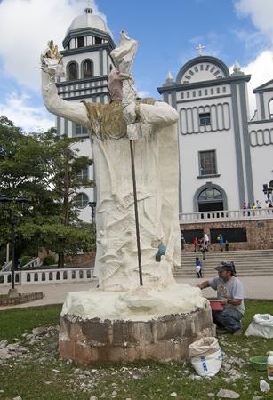 TEGUCIGALPA, HONDURAS - JANUARY 1 Unidentified sculpture making a statue of Pope John Paul II in the Suyapa Church on January 1, 2014 in Tegucigalpa, Honduras  Editorial