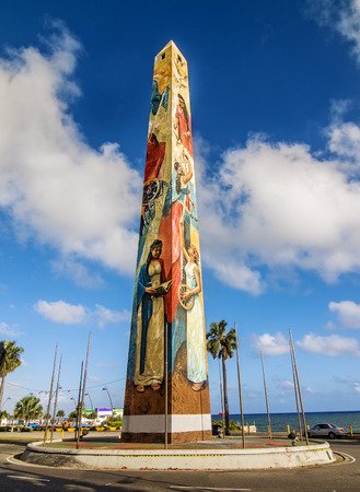 obelisco: STO DOMINGO, DOMINICAN REPUBLIC - FEBRUARY 13  The obelisk by the sea at Santo Domingo Malecon stands as one of  the city most recognized monuments  on Feb 13, 2014 in Sto Domingo, Dominican Republic