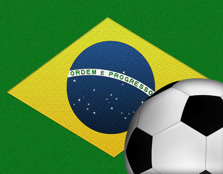 Brazilian Flag with a Soccer Ball in the Foreground Banco de Imagens