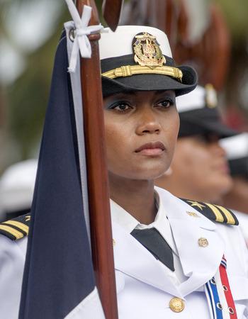 SANTO DOMINGO, DOMINICAN REPUBLIC - FEBRUARY 27  Military woman in uniform holding flag at the Independence Military Parade on February 27, 2014 in Santo Domingo, Dominican Republic   Editorial