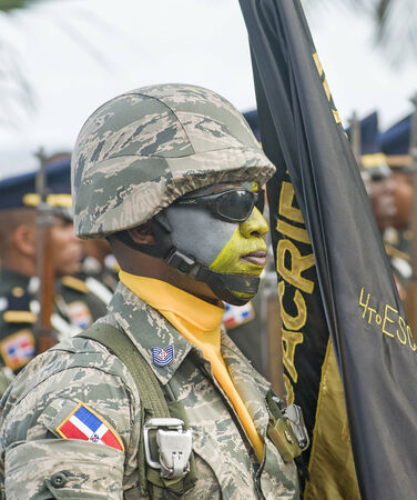 SANTO DOMINGO, DOMINICAN REPUBLIC - FEBRUARY 27  Soldier from the 4th squadron carrying group flag for the Independence Military Parade on February 27, 2014 in Santo Domingo, Dominican Republic  Editorial
