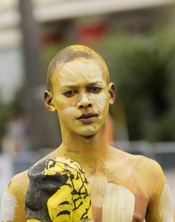 SANTO DOMINGO, DOMINICAN REPUBLIC - MARCH 2  Unidentified tribal painted young man at the public annual  Carnival in the Malecon streets on March 2, 2014 in Santo Domingo, Dominican Republic