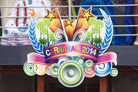 SANTO DOMINGO, DOMINICAN REPUBLIC - MARCH 2  Logo of the 2014 Carnival with  the queens dresses partially showing on top of platform  on March 2, 2014 in Santo Domingo, Dominican Republic  Editorial
