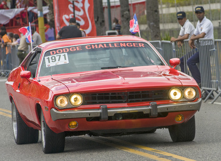 SANTO DOMINGO, DOMINICAN REPUBLIC - MARCH 2  Red 1971 Dodge Challenger parading in the vintage cars display during the public Malecon Carnival on March 2, 2014 in Santo Domingo, Dominican Republic