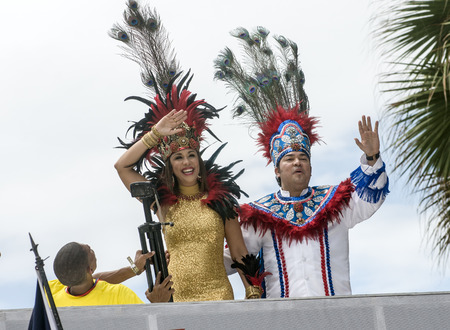 SANTO DOMINGO, DOMINICAN REPUBLIC - MARCH 2  Queen and King being photographed while waiving at the public annual Carnival at the Malecon streets on March 2, 2014 in Santo Domingo, Dominican Republic