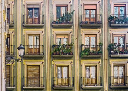 Pattern of Windows and Balconies on a Building Facade Banco de Imagens - 27959475