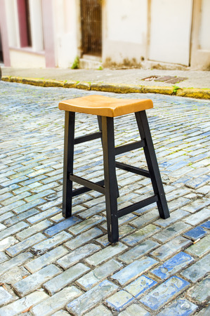 Stool in the middle of a cobblestone street in Old San Juan, Puerto Rico
