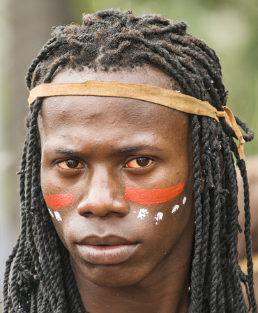 SANTO DOMINGO, DOMINICAN REPUBLIC - MARCH 2 Portrait of an Unidentified Taino man at the public annual Carnival in the Malecon streets on March 2, 2014 in Santo Domingo, Dominican Republic  Tainos are the original caribbean indigenous habitants before the