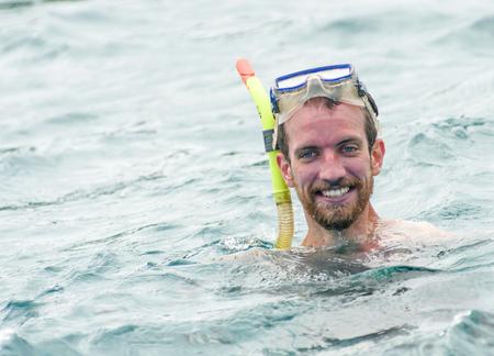 GALAPAGOS, ECUADOR - JUNE 13, 2011: Unidentified tourist snorkeling in Galapagos Island with burned skin. Volcanic Galapagos Islands is the most touristic place in Ecuador Banco de Imagens - 87146816