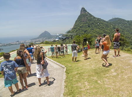 RIO DE JANEIRO, BRAZIL - DECEMBER 21, 2012: Helicopter taking off from heliport to offer visitors an aerial view of the city Banco de Imagens - 87146817