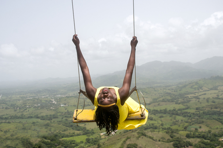 Woman swinging over the mountains