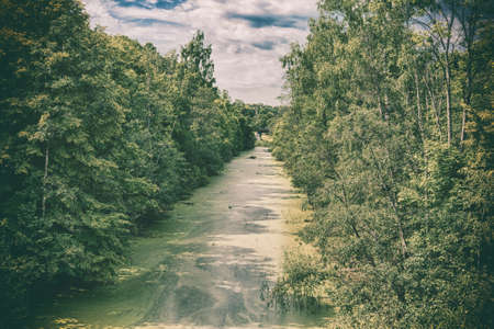 stylization: Scenic view of abandoned Mazursky canal, former West Prussia, old photo stylization