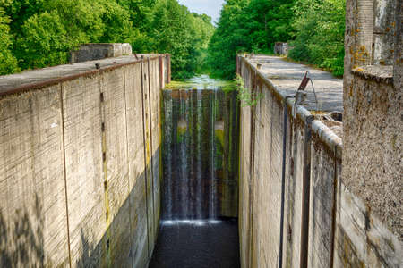 canal lock: Fifteen meters waterfall on an abandoned river lock, Mazursky canal, former West Prussia Stock Photo