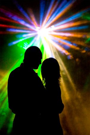 Dancer at the disco night club meeting Light rays photo