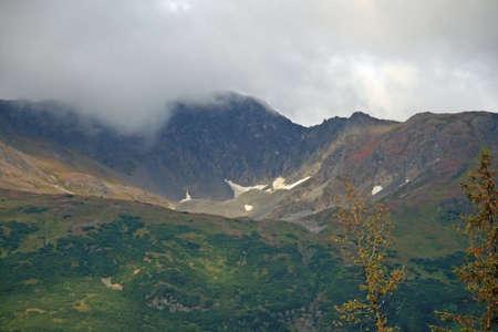 Fog over Alaskan Mountains photo