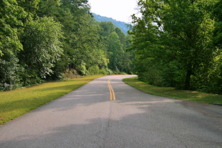 A road winding through the foothills of the Smoky Mountains. photo