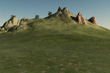 A grassy hill with boulders,stones, and plants.