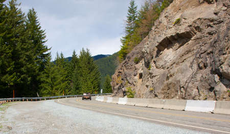 Winding road leading up a mountain in Washington. photo