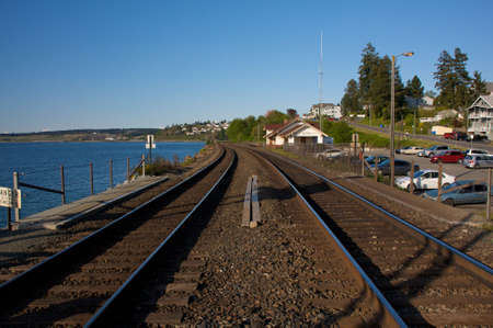 Railroad running through a coastal village in Washington. Stock Photo - 4898470