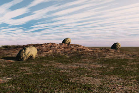 Large boulders and patches of grass on rough landscape. Stock Photo - 4908744