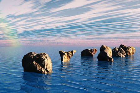 Large stones in the sea highlight this scenic view.