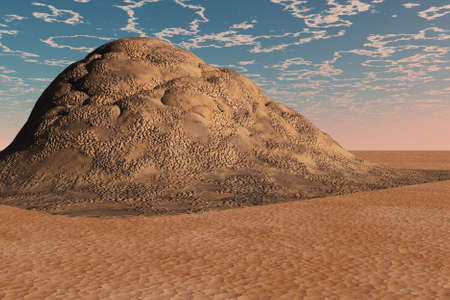 barren: Pile of rocky rubble in a mound surrounded by desert.