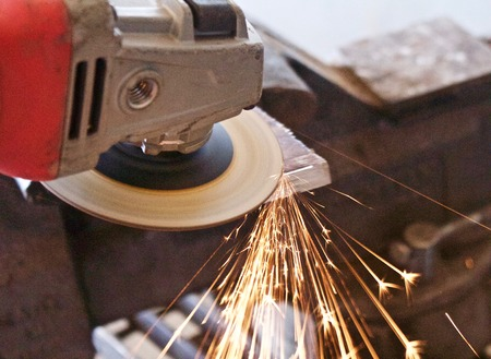 sparks fly from and angle grinder