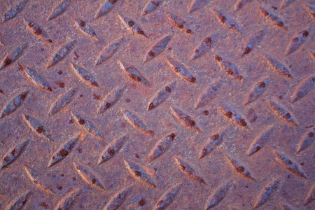 Close up view of rusted diamond plate steel