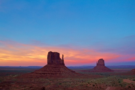 Monument Valley at Sunset, pink skies and red dirt