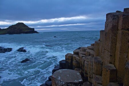 View of the Rocks of Giants Causeway with sea sprayed rocks and Ocean behind