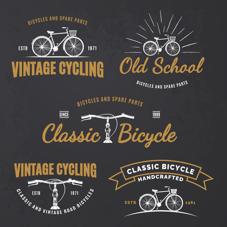 handcrafted: Set of vintage road bicycle labels, emblems, badges on grunge black background. Handcrafted bicycle repair, service and classic bicycle club design elements.